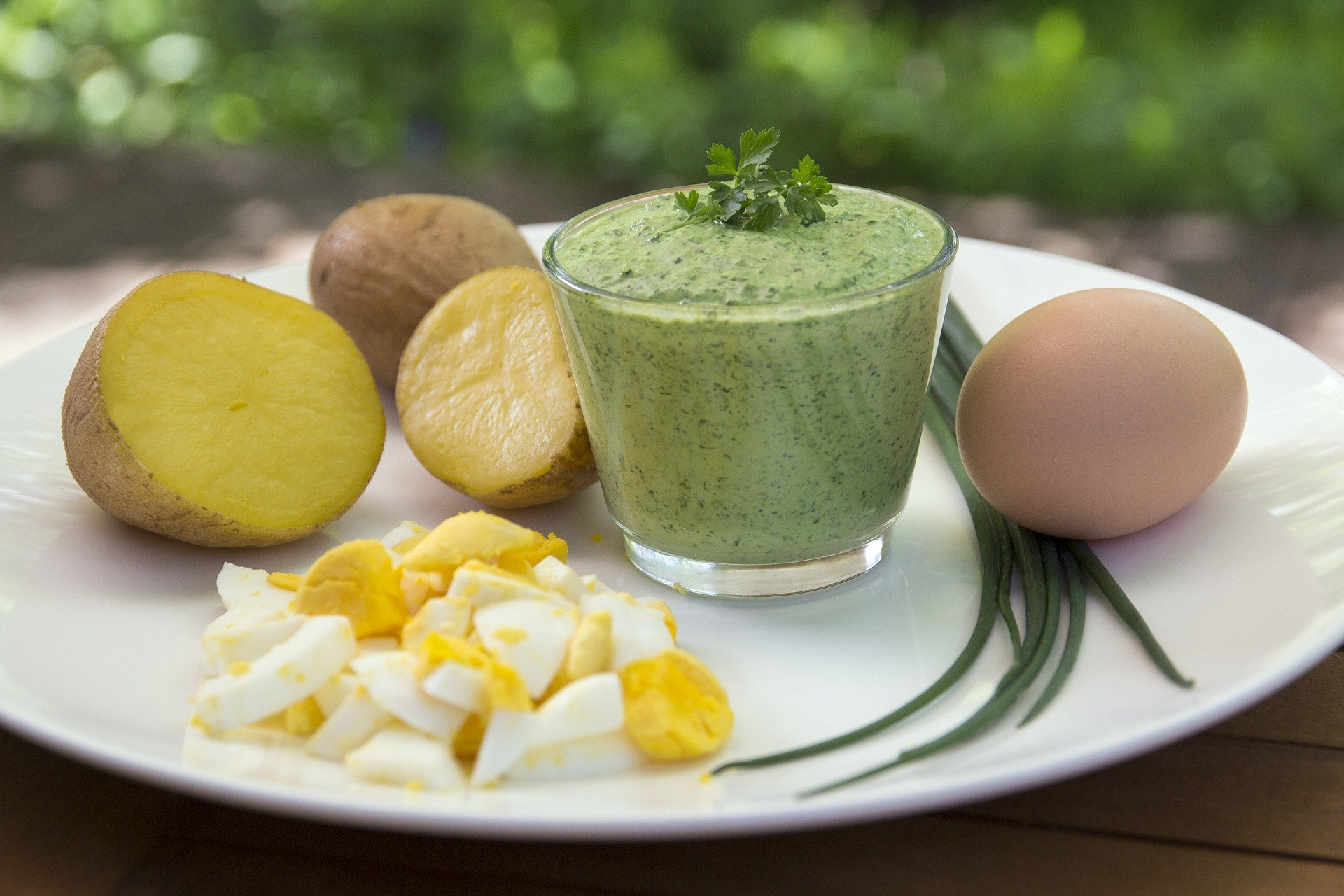 Frankfurt Green Sauce, arranged on a plate with potatoes and boiled egg