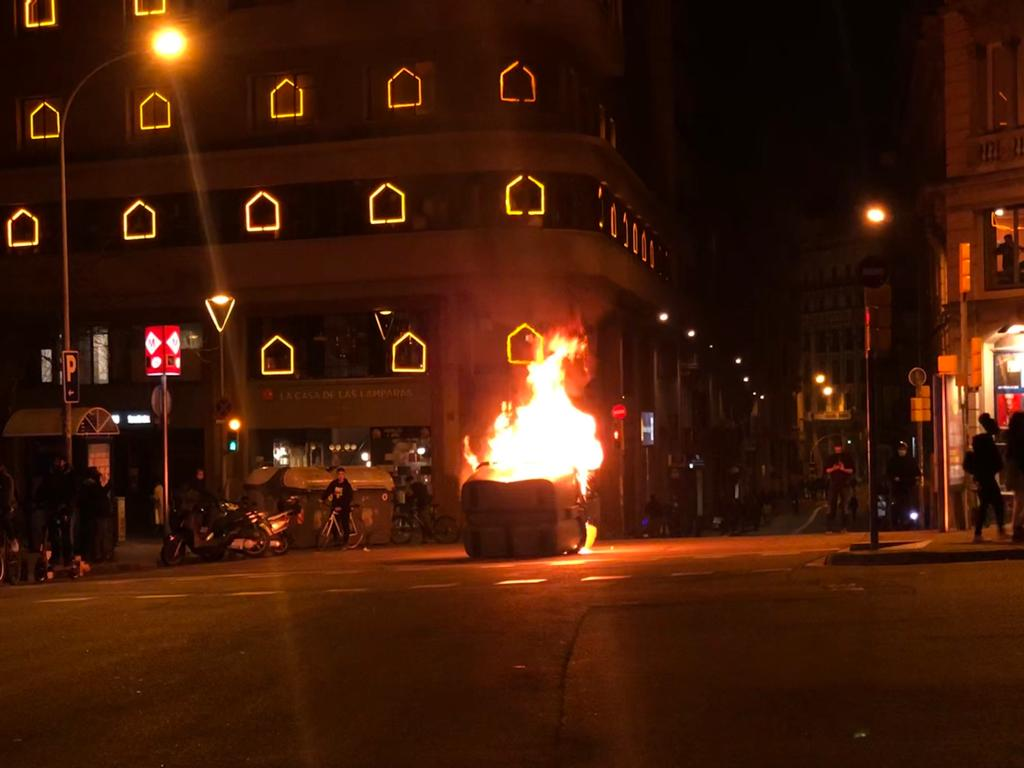 Protesters set fire to dumpsters in Barcelona