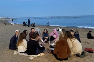 A group of Erasmus students enjoy the Barceloneta Beach